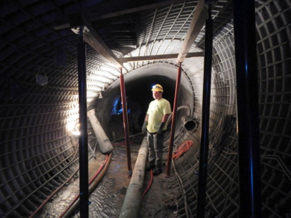 Installing reinforcing steel in a deformed CMP culvert prior to gunite application