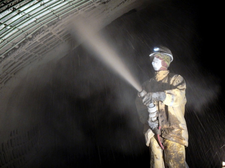 Nozzleman spraying gunite